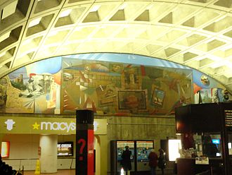 """Metro Center station - A mural, """"Scenes of Washington"""" by G. Byron Peck, is displayed at the 12th and G Street mezzanine."""