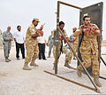 Military members with a partner nation practice building entry exercises with U.S. Airmen assigned to the 379th Expeditionary Security Forces Squadron during training at an undisclosed location in Southwest Asia 131120-F-EN483-039.jpg