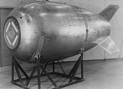 A large bomb resting on a cradle