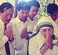 Mother Teresa praying at Borduria, a Nocte village.jpg