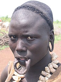 Contemporary Mursi woman showing pierced lower lip without a lip plate
