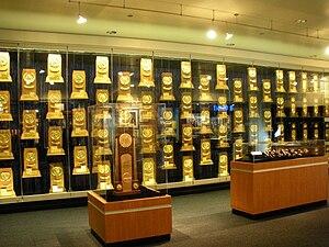 NCAA National Championship trophies, rings, wa...