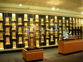 NCAA National Championship trophies, rings, wa...