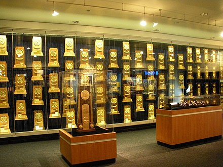 NCAA National Championship trophies, rings, and watches won by UCLA teams NCAA titles.jpg