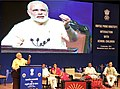 Narendra Modi addressing during his interaction with school children on eve of the Teachers' Day, at Manekshaw Centre, in New Delhi. The Union Minister for Human Resource Development, Smt. Smriti Irani.jpg