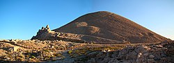 The man-made peak of Mount Nemrut with statues of gods and the assumed tomb of King Antiochus Theos of Commagene