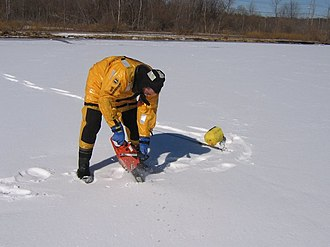 Ice diving - Cutting a hole in the ice to check the water conditions