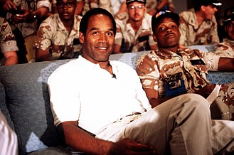 O. J. Simpson - Simpson in 1990 in Saudi Arabia while visiting American troops during the lead-up to the first Gulf War