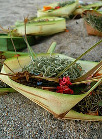 Offerings on the sand, Kuta Beach, Bali.JPG