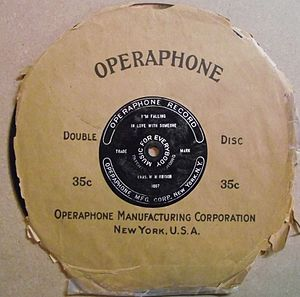 """Operaphone Records - Early, paint-filled etched-label 8"""" Operaphone disc and tattered original sleeve"""