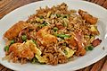 Orange chicken with bacon fried rice (16241424778).jpg