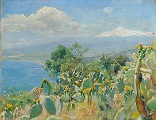 Flourishing cacti near Toarmina. In the background Mount Etna covered in snow.