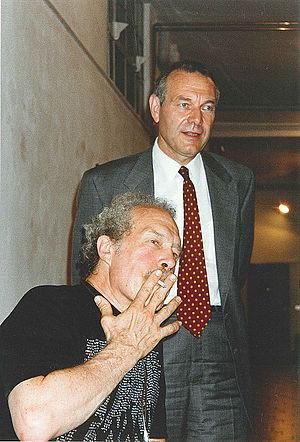 Archivio di Nuova Scrittura - Paolo Della Grazia (standing) with artist Dick Higgins.