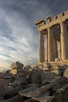 The ruins of the Parthenon in Athens, Greece. Much of the original marble which formed the roof and frieze now forms a pile of rubble at its base.