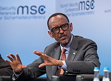 Kagame speaking, seated at a panel