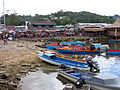 People transport goods from OBM boats to the old market in Auki, Malaita. (10712739765).jpg