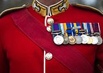 Pictured is a Welsh Guardsman wearing his Red Tunic. MOD 45159554.jpg