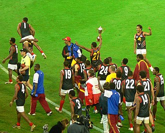 2008 Australian Football International Cup - The victorious Papua New Guinea Mosquitos celebrate winning the cup for the first time
