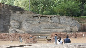 Petroglyph - Reclining Buddha at Gal Vihara, Sri Lanka. The remains of the image house that originally enclosed it can be seen.