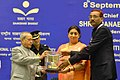 Pranab Mukherjee gave away the Saakshar Bharat awards, at the International Literacy Day celebrations, in New Delhi on September 08, 2015. The Union Minister for Human Resource Development, Smt. Smriti Irani is also seen (2).jpg