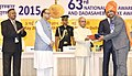 Pranab Mukherjee presenting the Rajat Kamal Award to the Producer Aushadh, Rep Shri Amol Deshmukh for Best Short Fiction Film, in Non-Feature Film Section, at the 63rd National Film Awards Function, in New Delhi.jpg