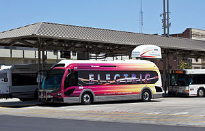 Electric bus - A battery electric Proterra BE35 bus operated by San Joaquin RTD, shown beside its fixed charging station.