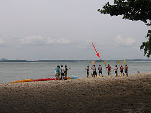 Pulau Sajahat - Location of Pulau Sejahat (red arrow) as seen from Changi Beach Park.