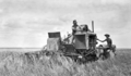 Queensland State Archives 4129 AutoHeader working in a crop Zeisemer Brothers Bongeen November 1934.png
