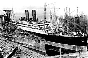 RMS Andania at Scott's Yard alongside HMS Ajax (1912)