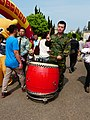 ROCA Soldier Beating Drum on Camp Road 20140329.jpg