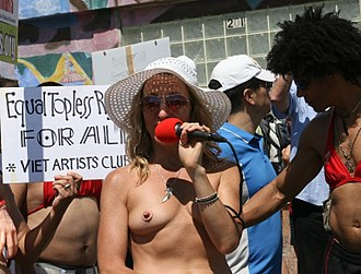 Topfreedom - A group of women protesting for the right to go topless anywhere a man could. Venice Beach, California, 2011 (demonstrator is wearing a pasty)