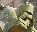 Rosheim, Romanesque sculpture of creature eating bread.jpg