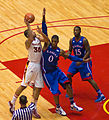 Royce White hook shot over Thomas Robinson.jpg