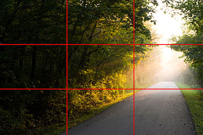 Rule of thirds: Note how the horizon falls close to the bottom grid line, and how the dark areas are in the left third, the overexposed in the right third.