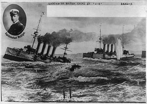 """Otto Weddigen - """"Victories of U-9"""" - a contemporary German postcard showing the photo of Weddigen against the background of the sinking """"Aboukir"""" and """"Hogue""""."""