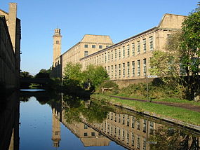 Titus Salt's mill in Saltaire, Bradford is a UNESCO World Heritage Site. Saltaire from Leeds and Liverpool Canal.jpg