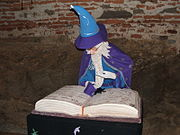 White-haired and -bearded wizard with robes and hat.