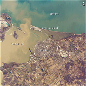 Sandusky, Ohio - Muddy brown water fills Sandusky Bay, just south of Lake Erie in this astronaut photograph.