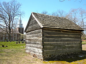 Schorn Log Cabin, ca. 1700, with the cemetery ...