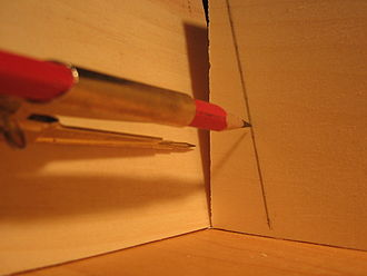 Coping (joinery) - Scribing a pencil line to fit two pieces of wood together.