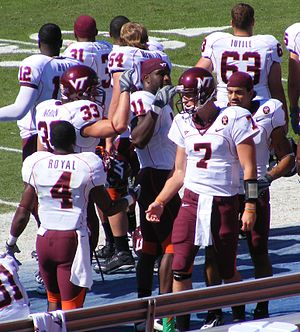 Sean Glennon - Glennon is congratulated by Eddie Royal after leading the Hokies to a touchdown in his first drive off of the bench in relief of the injured Tyrod Taylor