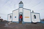 Secretary Kerry Emerges From the Chapel at McMurdo Station in Antarctica (30812065892).jpg
