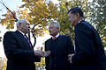 Secretary of Defense Chuck Hagel, center, and Secretary of Veterans Affairs Eric Shinseki, right, greet Colin Powell, a former secretary of state and national security adviser, during a Veterans Day event at 131111-D-BW835-1577.jpg