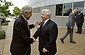 Secretary of Defense Chuck Hagel is greeted by Fred Downey as he arrives to meet with members of the Aerospace Industries Association in Arlington, Va., April 23, 2013.jpg