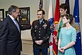 Secretary of Defense Leon E. Panetta visits with Army Staff Sergeant Clinton Romesha and his family, in his office at the Pentagon.jpg