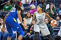 Seimone Augustus handles the ball against Glory Johnson in the Minnesota Lynx vs Dallas Wings game.jpg