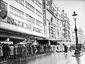 Service personnel and civilians queue for admission to the Empire and Ritz cinemas in London's Leicester Square, 1941. D2973.jpg