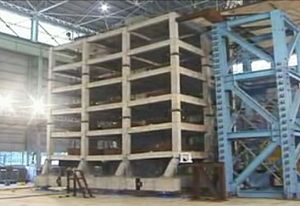 Earthquake engineering - Snapshot from shake-table video of a 6-story non-ductile concrete building destructive testing