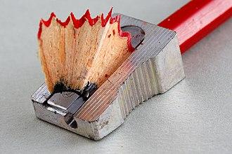 Pencil sharpener - A manual prism sharpener generates long fan-shaped shavings