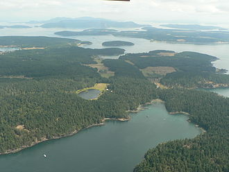 Shaw Island - Most of the southern half of Shaw Island (looking to the east), with the much smaller Canoe Island immediately past it, then Lopez Island most prominent in the background